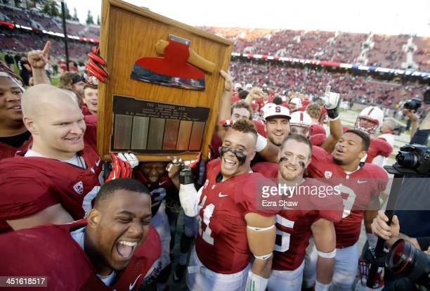 Stanford Cardinal players including Shayne Skov hold up the Axe after they retained the Axe for beating the California Golden Bears at Stanford...