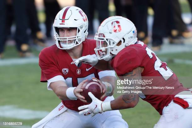 Stanford Cardinal quarterback Davis Mills hands off to Austin Jones for a touchdown in the fourth quarter against the Colorado Buffaloes, Saturday,...