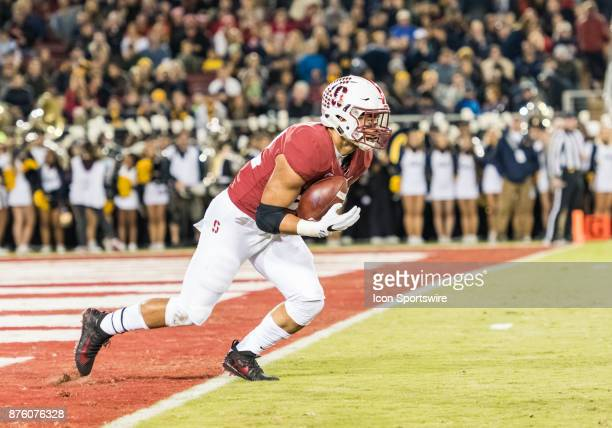 Stanford Cardinal running back Cameron Scarlett takes a kickoff just inside the field of play for a short run back during the regular season game...