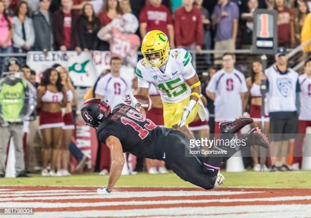 Stanford Cardinal wide receiver JJ ArcegaWhiteside bobbles a pass in the end zone while Oregon Ducks cornerback Deommodore Lenoir targets it during...