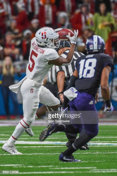 Stanford Cardinals wide receiver Connor Wedington hauls in a pass over the middle for a moderate gain during the Alamo Bowl game between the Stanford...