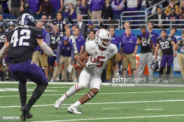 Stanford Cardinals wide receiver Connor Wedington looks for the goal line after a pass reception as TCU Horned Frogs linebacker Ty Summers defends...
