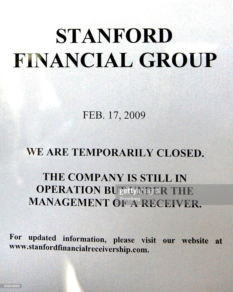 A Stanford Financial Group temporary closure notice sits on