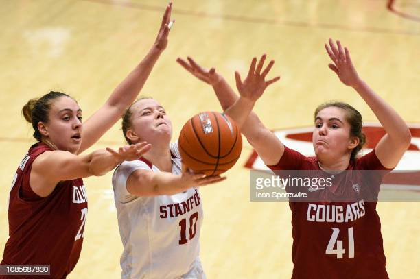 Stanford Forward Alyssa Jerome shoots under defense from Washington State Center Maria Kostourkova and Washington State Forward Jovana Subasic during...