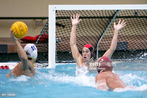 Stanford goalkeeper Chad Taylor covers as much of the goal as he can as UCLA's Josh Hewko prepares to shoot during the Division 1 Men's Water Polo...