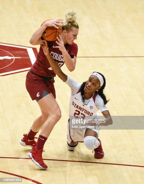 Stanford Guard Kiana Williams hits the deck for possession of the ball against Washington State Guard Alexys Swedlund during the women's basketball...