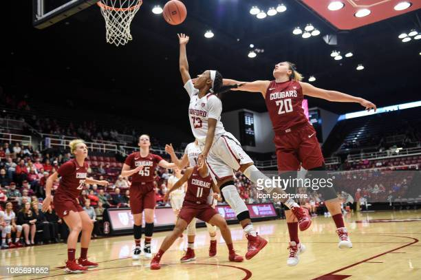 Stanford Guard Kiana Williams shoots a layup guarded by Washington State Center Maria Kostourkova during the women's basketball game between the...