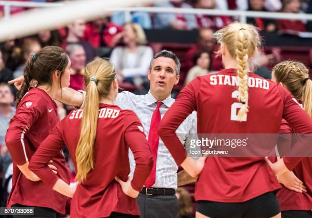 Stanford Head Coach Kevin Hambly goes over strategies with his team during the regular season game between the Oregon Ducks verses the Stanford...