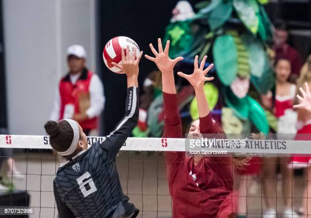 Stanford middle blocker Audriana Fitzmorris goes up for a block on a hit by Oregon middle blocker Lauren Page during the regular season game between...