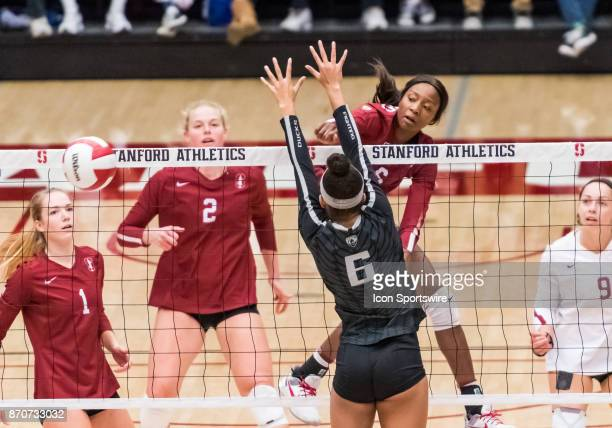 Stanford middle blocker Tami Alade slams the ball past Oregon middle blocker Lauren Page during the regular season game between the Oregon Ducks...