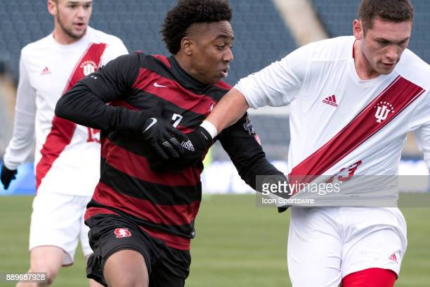 Stanford Midfielder Bryce Marion and Indiana Midfielder Francesco Moore battle for position in the second half during the College Cup game between...