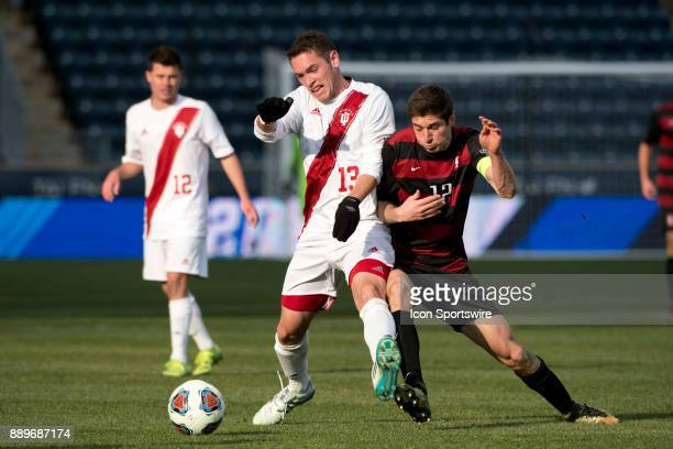 Stanford Midfielder Drew Skundrich and Indiana Midfielder Francesco Moore collide in front of the ball in the second half during the College Cup game...
