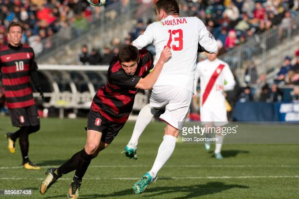 Stanford Midfielder Drew Skundrich pushes Indiana Midfielder Francesco Moore away from a header in the second half during the College Cup game...