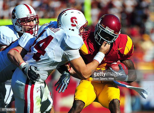 Stanford Nick Macaluso grabs the facemask of Joe McKnight during a college football game between the Stanford Trees and the USC Trojans played at the...