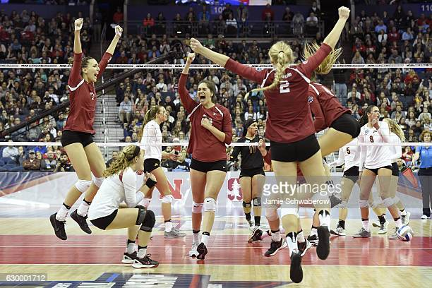 Stanford players celebrate their win over Minnesota in the Division I Women's Volleyball Semifinals held at Nationwide Arena on December 15 2016 in...