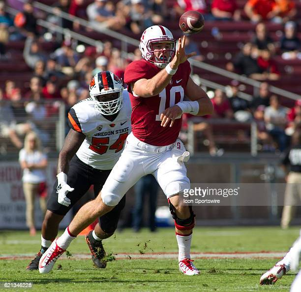 Stanford QB Keller Chryst flicks a pass while under pursuit by Oregon State OLB Shemiah UnutoaWhitson in the Pac12 game between the Oregon State...