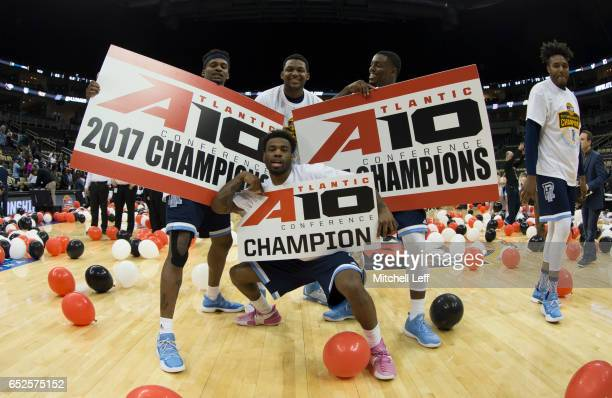 Stanford Robinson Nicola Akele Jarvis Garrett and Jared Terrell of the Rhode Island Rams pose for a picture after the game against the Virginia...