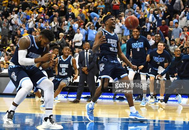 Stanford Robinson of the Rhode Island Rams celebrates after defeating the Virginia Commonwealth Rams 7063 during the championship game of the...