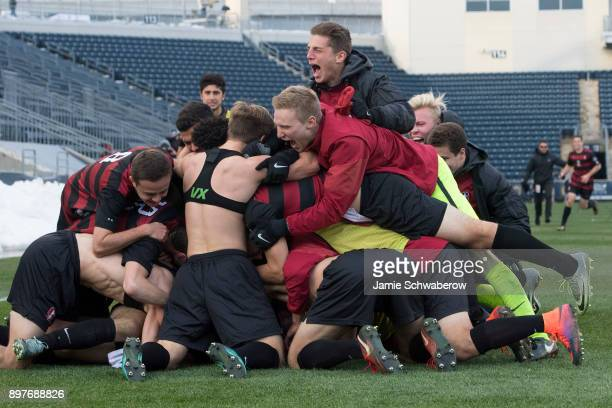 Stanford University celebrates their victory over Indiana University during the Division I Men's Soccer Championship held at Talen Energy Stadium on...