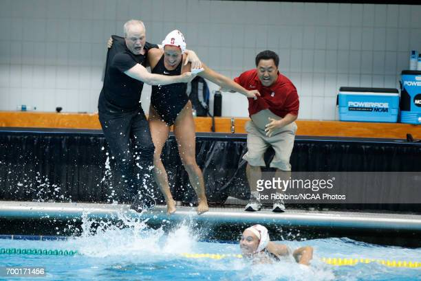 Stanford University coaches John Tanner and Kyle Utsumi celebrate with their players after winning the Division I Women's Water Polo Championship...