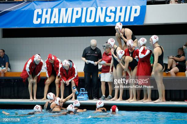 Stanford University players listen to instructions from head coach John Tanner during the Division I Women's Water Polo Championship against UCLA...