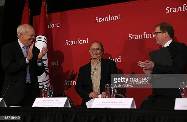Stanford University president John Hennessy and Stanford University dean of medicine Lloyd Minor applaud Stanford University School of Medicine...