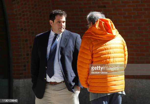 Stanford University sailing coach John Vandemoer left is seen outside the John Joseph Moakley United States Courthouse in Boston on March 12 2019...
