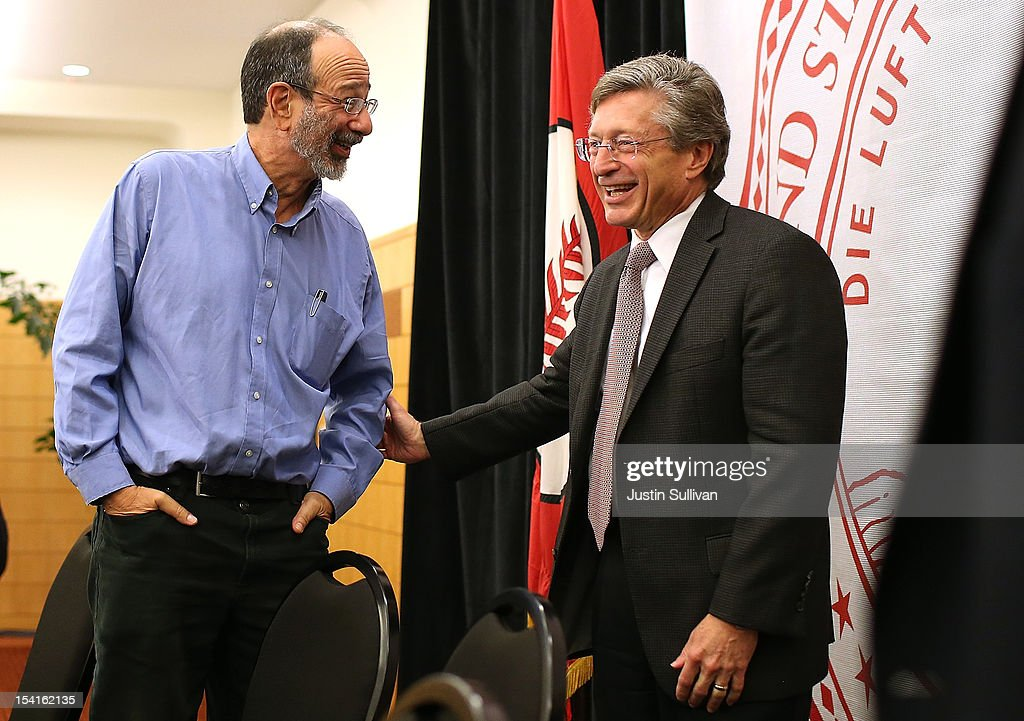 Stanford visiting professor Alvin Roth (L) talks with Stanford Provost John Etchemendy during a press conference announcing Roth's Nobel Prize in economics on October 15, 2012 in Stanford, California. Americans Alvin Roth and Lloyd Shapley were awarded the prize for their work on market design and matching theory.