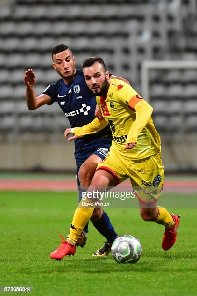 Stanislas Oliveira of Quevilly Rouen Metropole and Redouane Kerrouche of Paris FC during the Ligue 2 match between Paris FC and Quevilly Rouen...