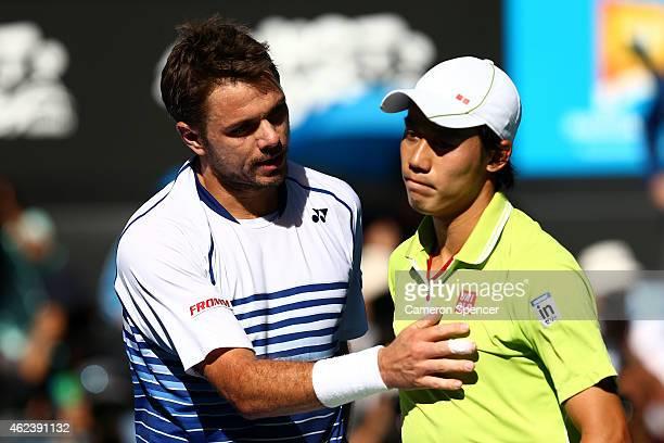 Stanislas Wawrinka of Switzerland and Kei Nishikori of Japan at the net after Wawrinka won their quarterfinal match during day 10 of the 2015...
