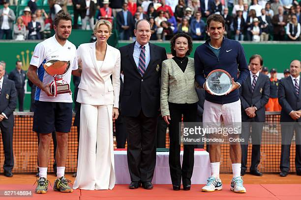 Stanislas Wawrinka of Switzerland and Roger Federer of Switzerland line up with Prince Albert II Princess Charlene and ElisabethAnne de Massy after...