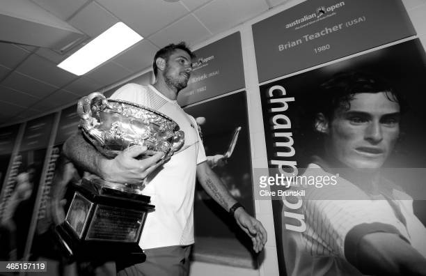 Stanislas Wawrinka of Switzerland carries the Norman Brookes Challenge Cup at the Walk of Champions after winning his men's final match against...