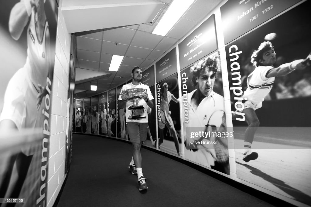 Stanislas Wawrinka of Switzerland carries the Norman Brookes Challenge Cup at the Walk of Champions after winning his men's final match against Rafael Nadal of Spain during day 14 of the 2014 Australian Open at Melbourne Park on January 26, 2014 in Melbourne, Australia.