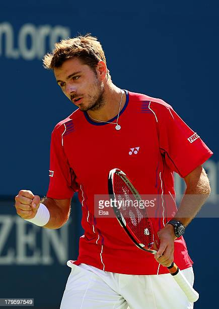 Stanislas Wawrinka of Switzerland celebrates a point during his men's singles quarterfinal match against Andy Murray of Great Britain on Day Eleven...
