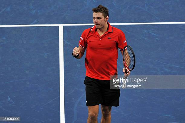 Stanislas Wawrinka of Switzerland celebrates his victory after his match against Ivan Dodig of Croatia during day two of the Swiss Indoors at St...