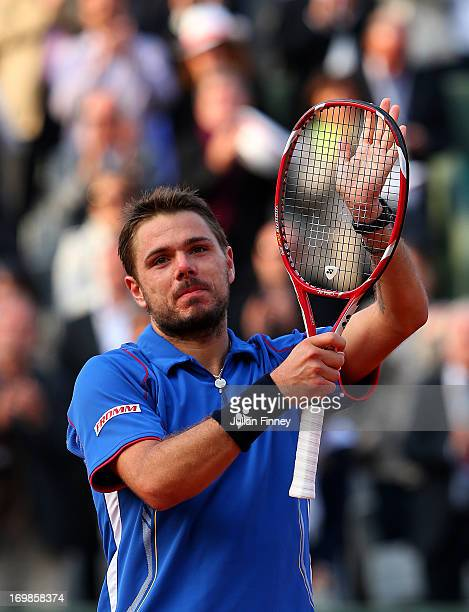Stanislas Wawrinka of Switzerland celebrates match point during his Men's Singles match against Richard Gasquet of France on day nine of the French...