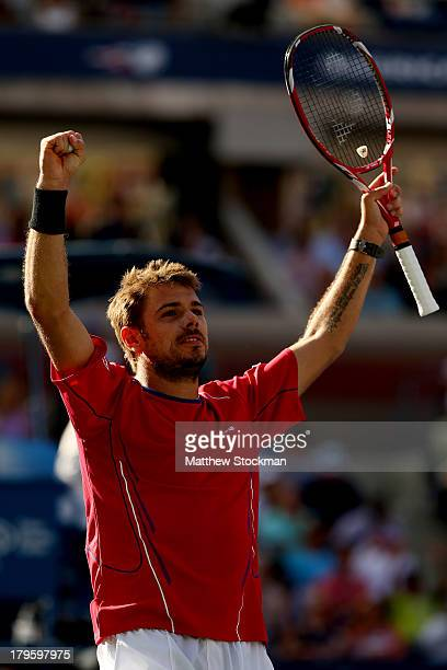 Stanislas Wawrinka of Switzerland celebrates match point during his men's singles quarterfinal match against Andy Murray of Great Britain on Day...