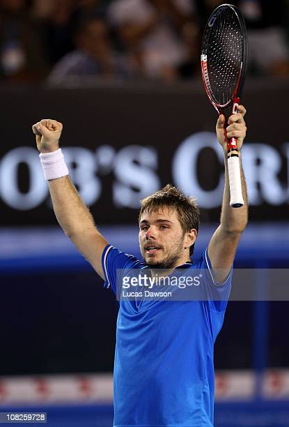 Stanislas Wawrinka of Switzerland celebrates match point in his fourth round match against Andy Roddick of the United States of America during day...