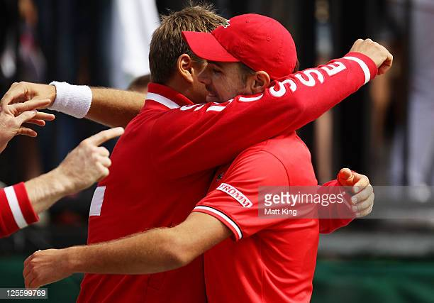 Stanislas Wawrinka of Switzerland celebrates with Marco Chiudinelli after winning his resumed Davis Cup World Group Playoff Tie match against Lleyton...