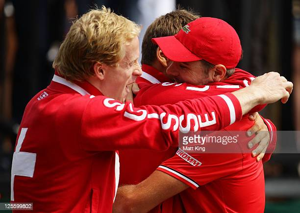 Stanislas Wawrinka of Switzerland celebrates with Marco Chiudinelli and Stephane Bohli after winning his resumed Davis Cup World Group Playoff Tie...