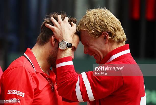 Stanislas Wawrinka of Switzerland celebrates with Stephane Bohli after winning his resumed Davis Cup World Group Playoff Tie match against Lleyton...