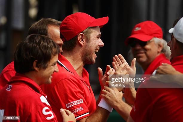 Stanislas Wawrinka of Switzerland celebrates with team mates after winning his resumed Davis Cup World Group Playoff Tie match against Lleyton Hewitt...