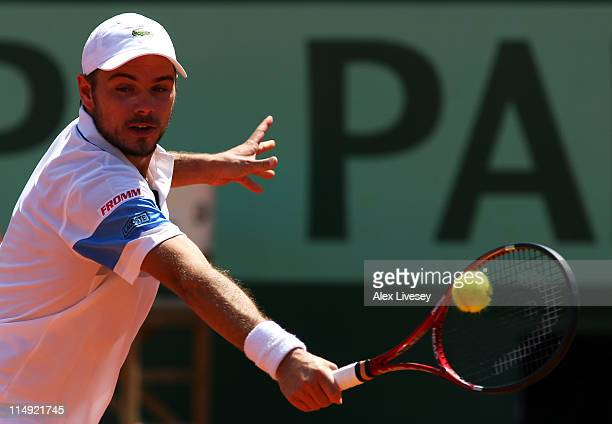 Stanislas Wawrinka of Switzerland hits a backhand during the men's singles round four match between Stanislas Wawrinka of Switzerland and Roger...