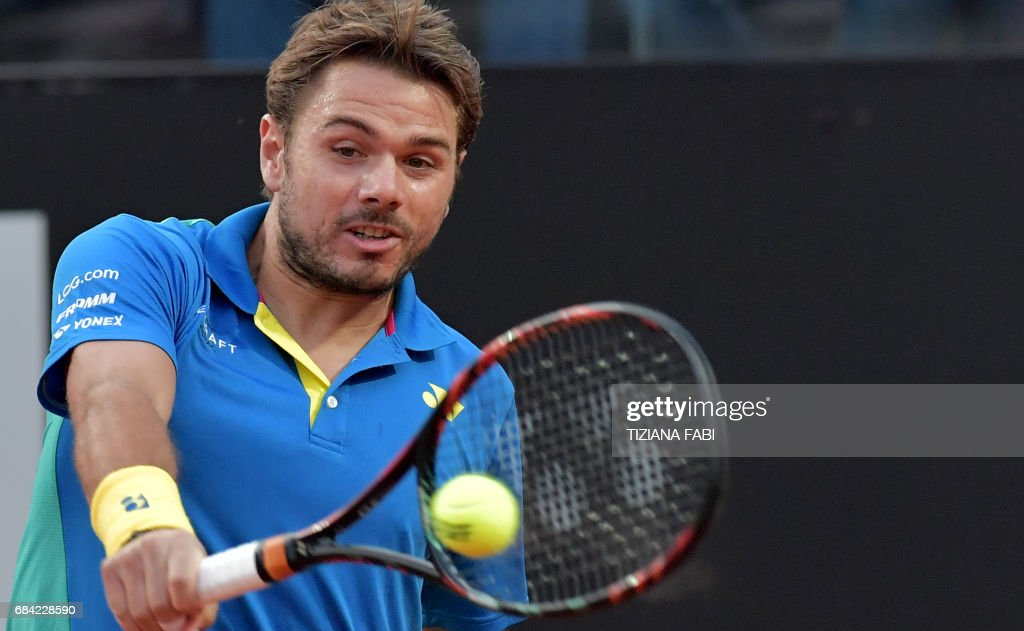 Stanislas Wawrinka of Switzerland hits a return to Benoit Paire of France during their match at the ATP Tennis Open tournament on May 17, 2017 at the Foro Italico in Rome. /