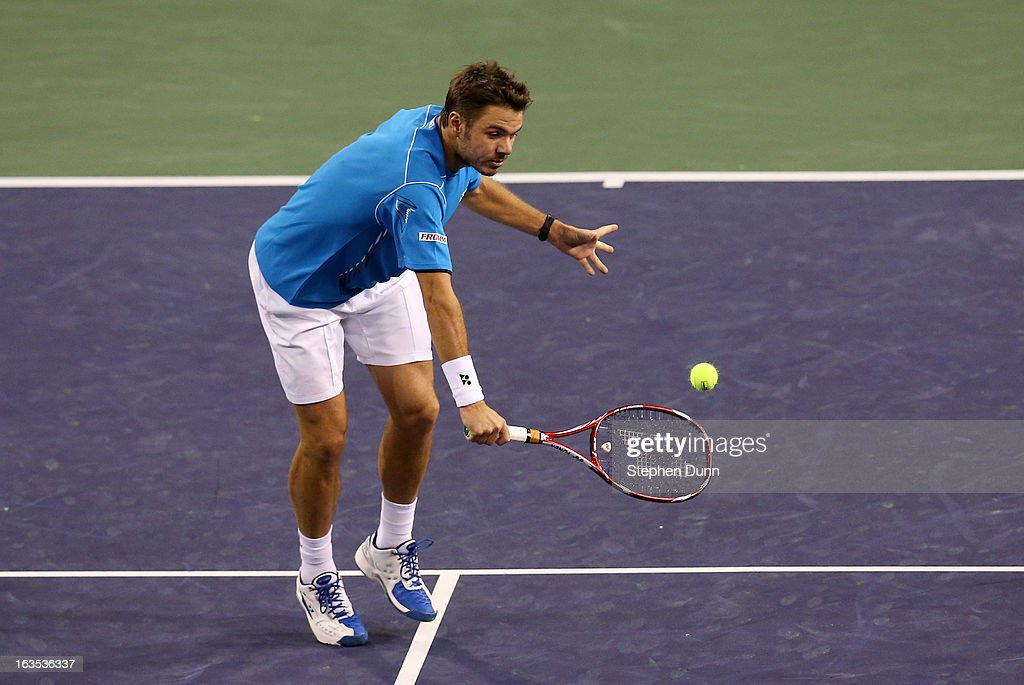 Stanislas Wawrinka of Switzerland hits a return to Lleyton Hewitt of Australia during day 6 of the BNP Paribas Open at Indian Wells Tennis Garden on March 11, 2013 in Indian Wells, California. (Photo by Stephen Dunn/Getty Images).