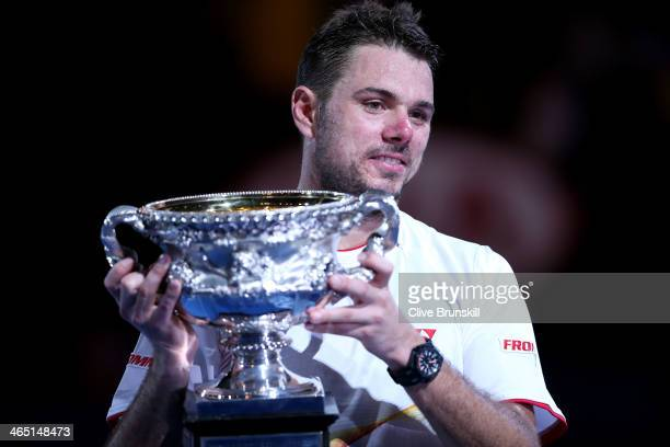 Stanislas Wawrinka of Switzerland holds the Norman Brookes Challenge Cup after winning his men's final match against Rafael Nadal of Spain during day...