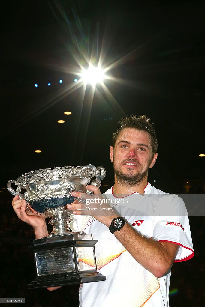 Stanislas Wawrinka of Switzerland holds the Norman Brookes Challenge Cup after winning his men's final match against Rafael Nadal of Spain during day 14 of the 2014 Australian Open at Melbourne Park on January 26, 2014 in Melbourne, Australia.