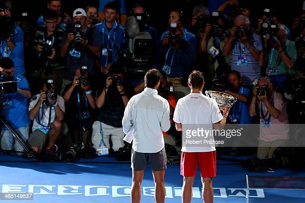 Stanislas Wawrinka of Switzerland holds the Norman Brookes Challenge Cup after winning, and Rafael Nadal of Spain holds the runner up plate after...