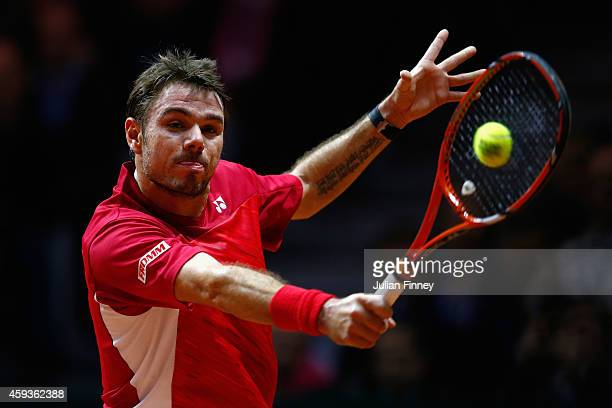 Stanislas Wawrinka of Switzerland in action against JoWilfried Tsonga of France during day one of the Davis Cup Tennis Final between France and...