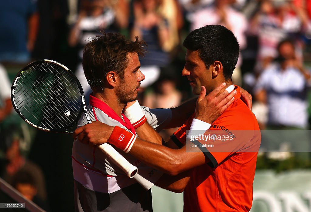Stanislas Wawrinka of Switzerland is congratulated by Novak Djokovic of Serbia after victory in their Men's Singles Final on day fifteen of the 2015 French Open at Roland Garros on June 7, 2015 in Paris, France.